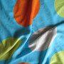 Látka modrá s barevnými puntíky